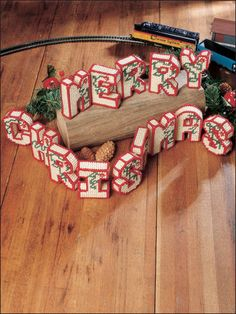 """3-D """"MERRY CHRISTMAS"""" stitched on 7-count plastic canvas using worsted weight yarn."""