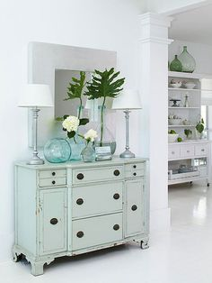 soft blue sideboard & blue glass vases