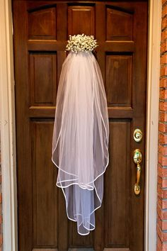 Bridal Shower decorations. Wedding veil from Hobby Lobby, a small block of oasis, and baby's breath!