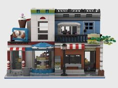 The Food Court is the place in town to satisfy all your nutritional needs. Walk into the candy shop and grab an icecream from the cooler or pick a cookie from the shelves. All cakes and cookies are homemade. Lego Food, Brick Construction, Lego Activities, Lego Trains, Lego Modular, Cool Lego Creations, Lego Parts, Lego House, Food Court