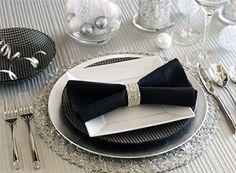 Round Silver Tinsel Placemat • Silver Lacquer Charger • Black & White Salad Plate • Allure Salad Plate • Black Pintuck Napkin with Silver Bangle Napkin Ring • Black & White Bowl • Paris Hammered Flatware • Platinum Stripes Stemware • Silver Mosaic Pillar