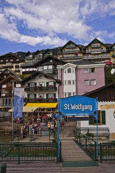 View of lakeside homes and businesses from lake cruiser moored at St. Baroque Architecture, Mountain Village, Central Europe, Salzburg, Alps, Places Ive Been, Travel Inspiration, Times Square, Explore