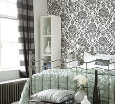 this only gets pinned because i'm a huge sucker for black and white damask. cool wallpaper.