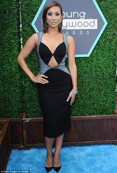 Cheryl Burke attended the Young Hollywood Awards in a grey and black number featuring a low neckline and cut-out at her abs http://dailym.ai/1nREkCI