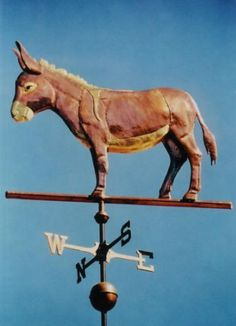 Standing Donkey Weather Vane by West Coast Weather Vanes. This handcrafted weathervane was customized with optional gold and/or palladium leafing on the mane, cross, belly, muzzle and tail, however, it can be made entirely in copper if you prefer.