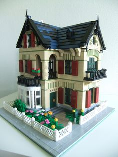 ~ Lego MOCs City ~ Corner building. Hous in the style of Art Nouveau / Jugenstil mixed with a kind of chalet style, as it is found in many more well to do neighbourhoods in the Netherlands. Windows are dark green, accents are olive green.