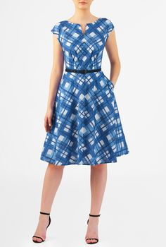 A split neck tops our cotton check print dress designed with an angled pleat bodice and removable contrast poplin belt at the seamed waist atop a full flared skirt.
