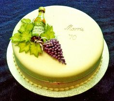 Hand moulded sugar grapes and vine leaves. Purple and green dusted sides.