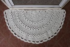 Half-circle rug made with t-shirt yarn & L hook.  Pic from Ravelry Project Gallery for this free pattern.  . . . .   ღTrish W ~ http://www.pinterest.com/trishw/  . . . .    #crochet #mat
