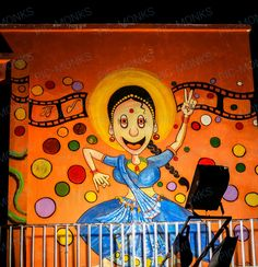Street art with a caricature of a woman dancer, who clearly enjoys her dancing. The art is an attempt to encourage the girl child