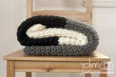 Chunky Crochet Blanket -- work this blanket up quickly.  Use the color combination that suits your style.  I like the idea of a neutral pallet for this very textural pattern.  www.thesweetersideofmommyhood.com.