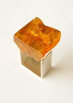 Beautiful ring from Baltic amber with partly preserved crust, polished, modern, irregular shape, front polished, from the side unpolished, raw, connected with matte silver 925. Comfortable square ring rail.  Size of the ring: ca. 21 mm x 20 mm Colour: Honey, orange, transparent  Weight: 7 g   Beautiful unique amber ring. This silver sterling ring with natural amber is out of time, it is perfect for any occasion.   All listed items are custom-made jewelry and unique pieces.  A nice detail to…