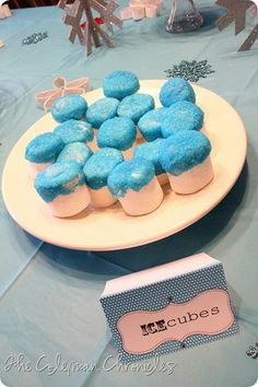 ice cubes - marshmallows dipped in white chocolate blue sprinkles - If I had time and was making a hot cocoa bar . . . totally.