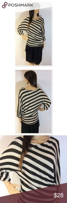 """FRENCH CONNECTION ASYMMETRICAL TOP Very pretty top in black and cream strips with gold sparkle throughout. 3/4 dohlman sleeves. Measurements lying flat Armpit to armpit 20"""" Length 27"""" French Connection Tops Blouses"""