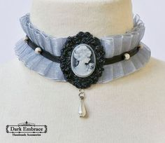 Dark Embrace Handmade Accessories - www.facebook.com/www.Dark.Embrace.Handmade.Accessories / Grey organza choker with black ribbon detail , black framed cameo lady cabochon and pearl beads / Shop: www.darkembrace.gr / #choker  #goth #gothic #gothicaccessories  #gothicchoker  #victorian #victorianchoker #victorianaccessories #ruff #ruffchoker #frame #cameolady