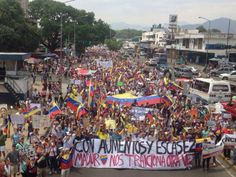 """4/6/2014 - Valencia, Venezuela anti-austerity protest  continue, however this is one aspect of among many taking place the sign reads: """"with inflation and shortages Maduro betrays us again"""""""