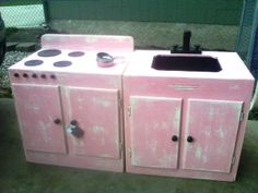 I love this idea!!! A few old cabinets, some felt and some other refinished kitchen items and you've got the cutest kitchen set ever!!! I've been looking non-stop for an old cabinet so I can make one for my daughter!!!       Character Corner Creations, I love you!!