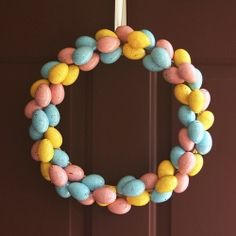 Learn how to make your own speckled egg wreath using materials found at the dollar store!