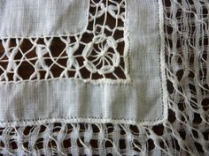 This is a fabric made by Extreme Pull work with Needle weaving often used to produce Antique Wedding Hankys. Made using linen yarn. Many techniques can be used to produce a material like this, these include  knotting threads, pulling threads and snipping to create pattern.