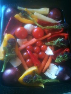 A selection of veg ready to slow roast in the oven in olive oil,herbs and garlic,to make a healthy soup and pasta dish.