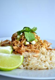 Skinny Crockpot Thai Peanut Chicken -- Boneless chicken breasts slow-cooked with a spicy Thai peanut sauce, and served on a bed of rice with a crushed peanut garnish.