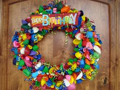 DIY Birthday Wreath Instructions - 500 or so balloons, straw wreath, U shape floral pins - put balloon in about 1/2 way and pin