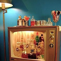Photo: Tune in to a new repurposing idea with an old console television.  Turn it into a lighted bar.