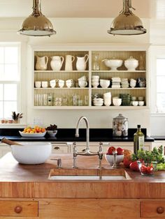 oyster table blak...bread table pine...white shelving above bread table...white shelving above pantry Real Couple Home Tour: In Plain Sight
