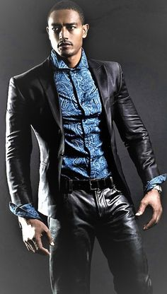 Very stylish looking guy in beautiful leather suit.