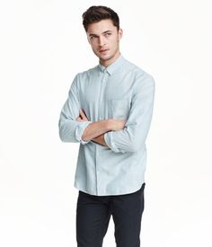 Long-sleeved shirt in washed oxford-weave cotton fabric. Button-down collar, chest pocket, and yoke at back with locker loop. Regular fit.