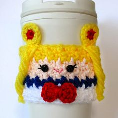 Leave it to Sailor Moon to help keep your coffee insulated and hands protected from hot beverages. This hand knit cozy comes in a charming crochet design and will fit snug over any standard sized coffee house cup.
