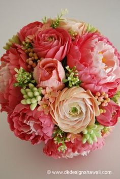 Bouqet:  Coral pink peonies in varying shades, ranunculus in coral pink and peach tones, hyacinth in peach with pink edged petals, tuberose buds with a peach hue, and tulips