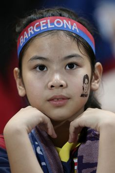 A young Barcelona fan waits for players to come onto the pitch during the international friendly match between Thailand XI and FC Barcelona at Rajamangala Stadium on August 7, 2013 in Bangkok, Thailand.