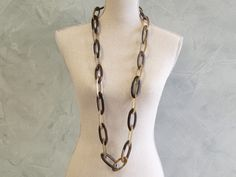 Horn and wood links necklace.