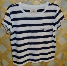"""- For - junior girls, - Status - preworn, - Condition - good, - Size - S, - Color - dark blue, white, - Material - ?? cotton, - Width - 17"""", - Height - 19-1/4"""", Comments: the little sleeves have a cuf"""