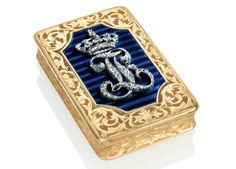 A FRENCH JEWELLED ENAMELLED GOLD ROYAL PRESENTATION SNUFF- BOX BY ARTHUR GOOSSENS (FL. 1847-1863), MARKED, PARIS, CIRCA 1850,  STRUCK WITH A POST-1838 PARISIAN GUARANTEE MARK FOR GOLD, rectangular box with rounded corners, the cover centred with a shaped cartouche of  translucent blue enamel on an engine-turned ground and applied with old-cut diamond  silver-mounted entwined Gothic initials F L, a Royal crown above - Dim: 3 1/2 in. (86 mm.) wide
