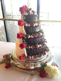 4 tiered wedding cake covered in chocolate and vanilla fondant with chocolate covered strawberries.  Fresh roses and babies breath  used to accent the cake email: amandawade1980@gmail.com phone # 817-903-5316