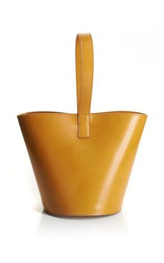 Mustard Brushed Leather Bucket Bag by J.W. Anderson for Preorder on Moda Operandi