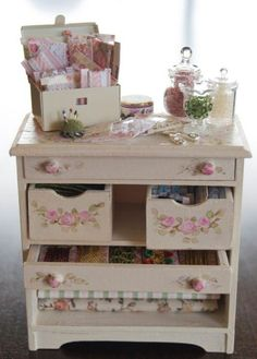 lovely mini sewing supply dresser !!