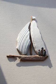 "sharon nowlan pebble art - Why didn't I ever connect broken clam shells with being the perfect ""sails"" for my driftwood sailboats?  DUH! Brilliant!!.....vwr"