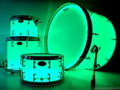 Neon green illuminated acrylic drum set by Stauffer Percussion