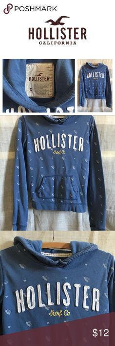 Hollister hooded sweatshirt Hollister hooded sweatshirt. Pre-loved in great condition. Blue sweatshirt with white lettering and white details. Pocket in front. String ties on hood Hollister Tops Sweatshirts & Hoodies