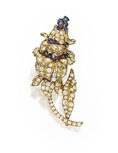 18 KARAT GOLD, DIAMOND AND SAPPHIRE BROOCH, LA CLOCHE, CIRCA 1950 Of floral design, set with 13 round sapphires weighing approximately 1.30 carats and numerous round diamonds weighing approximately 11.80 carats, signed La Cloche, Paris, with French assay and workshop marks.