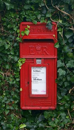 An iconic British red post box. You've Got Mail, England, Post Box, British Isles, Shades Of Red, Great Britain, My Favorite Color, Red Color, Green Colors