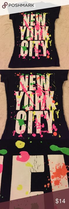 Black New York City Paint Splatter T-Shirt Awesome NYC Paint Splatter T-Shirt! It's a size medium but would probably fit an X-Small/Small better. The shirt has been worn once or twice but it's in great condition. The paint on a couple of the words is creased as shown in the photos. Tops Tees - Short Sleeve