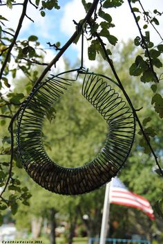 Zita May's homemade bird feeder = hanger + slinky.