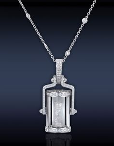 Jacob &Co. Jacob & Co. Diamond Hourglass Pendant Featuring: 0.80 Ct Round Floating Diamonds, & 2.08 Ct Round Brilliant Cut Diamonds Delicately Set in a Pave' Setting on Stainless Steel, Hanging on an 18K White Gold Chain.
