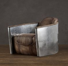 Aviator Swivel Chair. Saw this chair today at Restoration Hardware and it is so cool. Wish I had somewhere to put it!