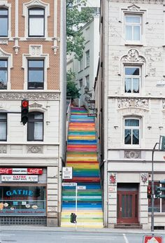 Colourful stairs bring new life to an old, drab space.