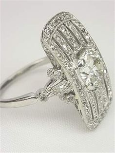 This fabulous Edwardian antique engagement ring shines like the brightest stars in a moonlit sky. #AntiqueJewelry